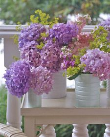 Good old Martha does it again. White painted coffee cans + beautiful blooms = fabulous