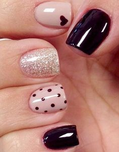 Impressive nail art design with black dots and hearts