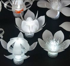 Sarah Turner - Plastic Bottle Tea Lights MoreFREE UK DELIVERY These cute little flowers are each illuminated with a white LED tea light. Each flower recycles one waste plastic bottle. After collecting theDIY Candle Holder Bottle Recycled Project Bott Plastic Bottle Flowers, Plastic Bottle Crafts, Recycle Plastic Bottles, Recycled Bottles, Recycled Crafts, Diy And Crafts, Burlap Crafts, Diy Pet, Paper Flowers