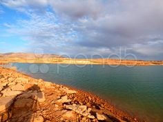 Lake Shore, Red Rocks, Green Water - Stock Footage | by Iam2012escapee Lake Mead, Rocky Shore, Lake Shore, Lakes, Stock Footage, Pond, Rocks, Ocean, Sky