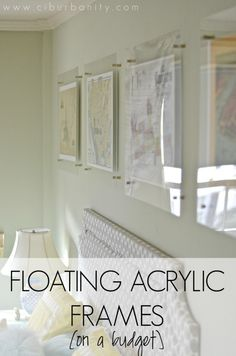 Floating Acrylic Frames on a budget... these were so simple to make and are still a favorite DIY for our master bedroom.