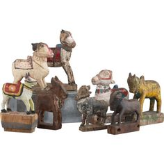"""Vintage wooden toys, discovered in the Rajasthan and Gujarat regions of India, depicts the sacred gais (""""cow""""), a Hindu symbol of wealth dating back to the Vedic period (1500–900 B.C.). Revered in the teachings of Lord Krishna as the living symbol of Mother Earth, the cow is treasured as a most important member of the family—which these figures can lovingly attest to. Just as a village's cows are brightly painted and decorated during Gopashtami (""""cow holiday""""), these handcarved found objects…"""