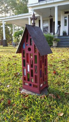 Purpleheart stained glass birdhouse.  Created by Jefferson Garvey, Recycling is for the birds!