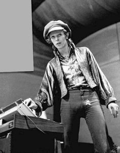 """bowieheadwear: """"David Bowie wears a hat and flower bulge look at it what the fuck """""""