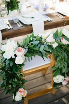 eucalyptus and garden rose garland, photo by John Newsome http://ruffledblog.com/romantic-la-jolla-beach-wedding #garland #flowers