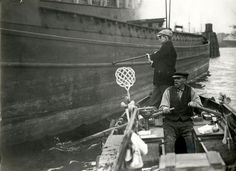 Pedlar Pieter Kooy from Rotterdam with his floating store in Rijn port in Rotterdam, The Netherlands, 1928.