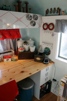 1960 Streamline travel trailer turned stationary CRAFT  STUDIO!, milk glass containers hold flowers. ...