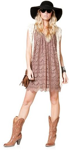 Lace dress, crochet vest, cowboy boots, and wide brimmed hat.  I feel a music festival coming on.