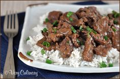 Crock Pot Mongolian Beef Recipe Main Dishes with flank steak, corn starch, soy sauce, white wine, cooking sherry, white wine vinegar, sesame oil, molasses, ginger, onion, black pepper, crushed red pepper flakes, brown sugar, peanut butter, garlic, scallions