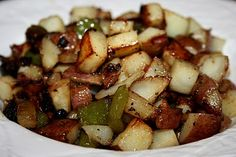 Red skin potatoes are fried up in a cast iron skillet with sweet Vidalia onion and bell pepper and nicely seasoned for a take on Potatoes O'Brien. Great for any meal - add fresh herbs if you like!