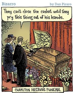 """""""They can't close the casket until they pry this thing out of his hands."""" Charlton Heston's funeral. Bizarro"""
