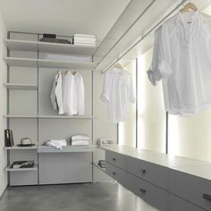 white modern dressing room design for men Many still think that the dressing room is a welfare of spoiled fashionable women who live in vast palaces. In fact, the organization of even a small dressing room is a reasonable and functional solution that hel