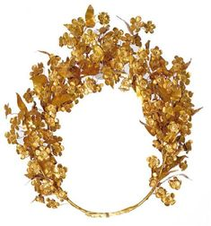 """Meda's wreath from the tomb of Philip II Gold, some 80 leaves and 112 flowers surviving, c. 310 BC, diameter 26 cm """"This gold myrtle wreath is amongst the most precious objects found in the antechamber of the tomb of Philip II. It is associated with his wife, the Thracian princess, Meda."""""""