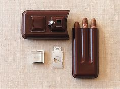 Perfect for a night out with the guys or a weekend away, this well appointed accessory has a practical side as well- it keeps your cigars from getting crushed or damaged. Made from rich, mahogany colored leather, it holds up to three cigars. Included in the set is a stainless steel cigar cutter and lighter.