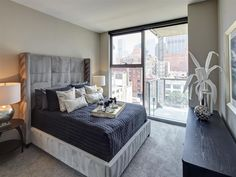 Bedrooms with floor to ceiling windows connect to private balconies overlooking the city below. The Line Apartment, Interior And Exterior, Interior Design, Floor To Ceiling Windows, Cribs, Building A House, Chicago, Floor Plans, Flooring