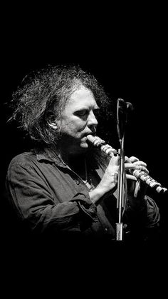 Robert Smith... how many instruments does he play?  Piano, guitar, wind