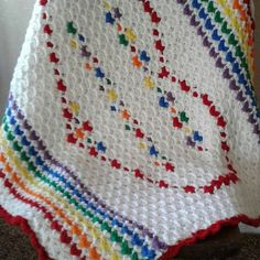 Handmade, double sided, reversible baby blanket. This blanket measures about 34 x 37 it is made using acrylic yarn. As a finished product the blanket is rather heavy. It would be great in the colder climates in the winter. Living here in the southwest, it would make a great comfy play