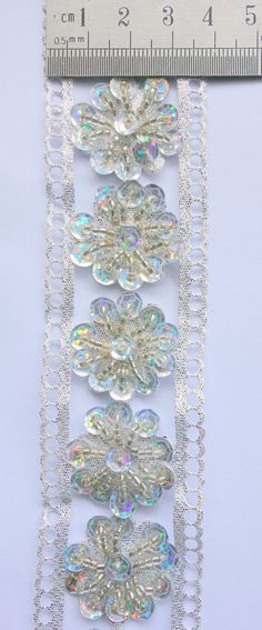 Silver Handmade Trim floral with beading by ColourCocoon on Etsy, $6.00
