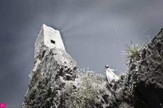 by: ikigrafie. debora de Jong #reachingout #roquebrun #ruin #topofthehill #whitedress #trytofly #rocks #france #artoftheday #pictureoftheday #womeninwhite #darksky