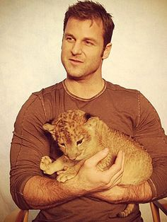 Dave Salmoni plays with a 5-week-old lion cub in the PEOPLE studios