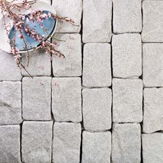 Economical and durable, Fujian white is a quality granite that welcomes attention. With proven durability, it is the perfect addition not only to a busy outdoor entertainment area but, to many other elements of our collection too.  Herculean in strength, this hardy stone is faultlessly suited to high foot traffic and vehicle exposure, offering flexible application on driveways and around pools. Mountainous Terrain, Igneous Rock, Black Quartz, Chinese Tea, Outdoor Entertaining, Terracotta, Granite, Interior And Exterior, Stone