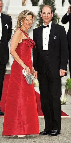 PRINCE EDWARD & SOPHIE, COUNTESS OF WESSEX...After greeting the crowd, the Queen's youngest son helps wife Sophie, who was reportedly injured in a riding accident earlier in the week, climb the stairs to the evening's festivities, the Queen's private dinner. The couple's daughter, Lady Louise Windsor, will serve as a bridesmaid in cousin Prince William's wedding. Thursday April 28, 2011
