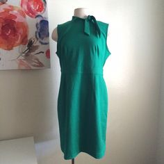 Green dress Beautiful green dress. Slightly fitted at the waist. Sleeveless. It ties around the neck. Very stretchy! Very retro! 76% polyester, 20% rayon, and 4% spandex. It has a couple seams that are coming up but it doesn't affect the dress. Merona Dresses