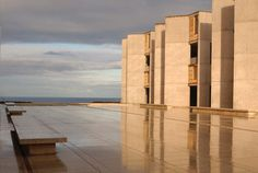 """The Salk Institute was established in the 1960s by Jonas Salk, M.D., the developer of the polio vaccine. His goal was to establish an institute that would explore questions about the basic principles of life. In December 1959, Salk and architect Louis Kahn began a unique partnership to design such a facility. Salk summarized his aesthetic objectives by telling the architect to """"create a facility worthy of a visit by Picasso.""""  Located in La Jolla, California, 1962"""