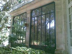 Photo baie vitree acier renovation pierre de taille double vitrage