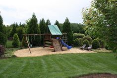 """From photo comments:  Backyard swingset and play area with seating for parents.  Graham Kimak Landscape Designs. """"The ground surface in the playset area is TumbleSafe mulch, a natural wood mulch that is specially intended for playgrounds and similar applications."""""""