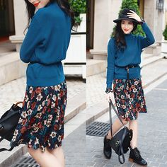Sweater over printed dress