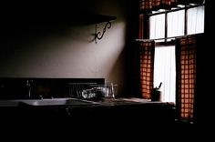For all my love of crisp, white kitchens, I'm taken by the stark beauty of this shot (by Amy Merrick, via Flickr)