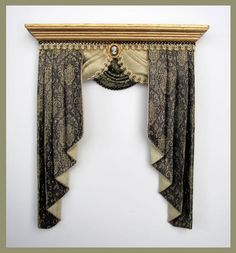 Curtains. Love the cameo! The pelmet and draping is nice too.