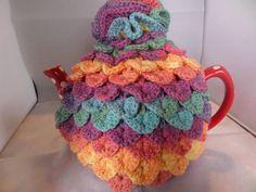 Crochet tea cosy Crocodile stitch Dark pastels Frilled top Crocodile Stitch, Frill Tops, Top Knot, Hand Crochet, No Frills, Pastels, Cosy, Shapes, Tea