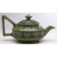 """Roseville Rozane, Katy Duvall, decorator, in collaboration with an unknown decorator (E.B.), Della Robbia teapot, Zanesville, OH, carved and polychrome glazed ceramic, marked, signed, 9""""w x 4.5""""h overall"""