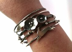 English Garden Bangle Set - Sterling Silver Stacking Bangles with Flowers, Butterflies, Buds, Feather, and Rabbit by TheIrishDaisy on Etsy https://www.etsy.com/listing/235190709/english-garden-bangle-set-sterling
