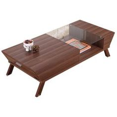 """Featuring a midcentury-inspired design, this artfully angled coffee table features a glass inset and ample storage space behind drop-down side panels. Product: Coffee tableConstruction Material: Wood, medium fiberboard, veneers and glassColor: WalnutFeatures: Glass top Open shelf belowDrop down side panels with interior storage spaceDimensions: 12.8"""" H x 47.3"""" W x 21.7"""" D"""