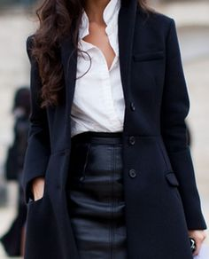 White blouse, leather pencil skirt, long curls