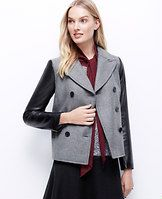 """Faux Leather Sleeve Jacket - Meet our newest must-have, luxuriously outfitted with faux leather sleeves. Peak lapel. Faux leather long sleeves. Double breasted button front. On-seam vertical welt pockets. Lined. 24"""" long."""