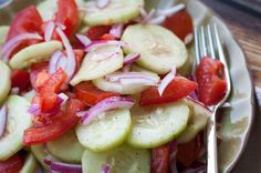 Got vinegar? This Marinated Cucumber Salad recipe with tomatoes and onions is super tangy and tasty. A recipe I've loved since childhood!