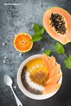Smoothie Bowl with papaya, orange, mango and pollen