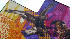 3Steps | Birds of Prey | eagles | colors | colours | patterns | Germany | Giessen | blue | yellow | pink | purple | architecture | mural | graffiti | urban | Art | sky