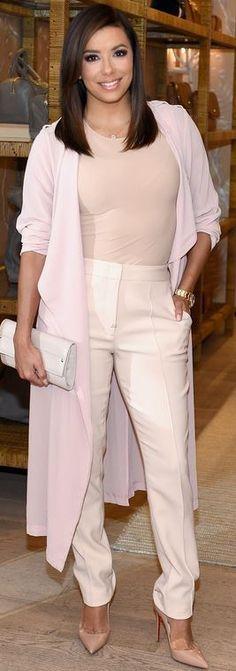 Eva Longoria:Coat – Asos  Shirt – Margiela  Pants – BCBG  Purse – Jimmy Choo  Shoes – Christian Louboutin