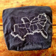 """The MADE SOUTH T-shirt is made of cotton that is 100% grown and sewn in the Carolinas. It is a beautiful, soft vintage black with a white """"recharge"""" print. That means the imprint on this shirt will not crack, fade or peel over time."""