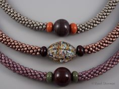 Kumihimo necklaces with glass focal beads