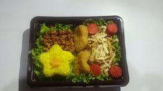 Nasi kuning + Kering tempe + Chicken nunggets + Mie goreng + sosis goreng