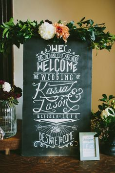 chalkboard wedding sign - photo by Amber Vickery Photography http://ruffledblog.com/modern-philadelphia-wedding-with-a-black-gown #weddingsign #signs #signage