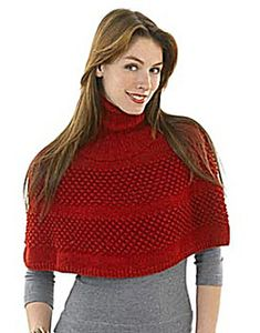 Go glamorous with this chic, shapely turtleneck capelet worked in the round in shimmery Glitterspun. The turtleneck frames a pretty face; textural stitching adds to the interest. (Lion Brand Yarn)