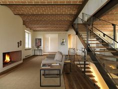Love the lines and brick ceiling