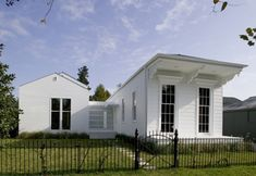 """A great """"modern"""" addition/restoration of a New Orleans shotgun.  Love how the addition to the left doesn't demand any attention with the offset windows."""